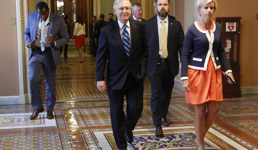 Senate Majority Leader Mitch McConnell of Ky., with his director of operations Stefanie Hagar Muchow, right, walks to his office on Capitol Hill in Washington, Tuesday, July 11, 2017. (AP Photo/Pablo Martinez Monsivais)