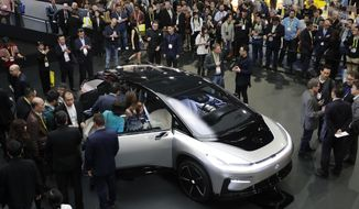 FILE - In this Jan. 3, 2017, file photo, Faraday Future's FF 91 electric car is unveiled during a news conference at CES International in Las Vegas. Electric car maker Faraday Future said Monday, July 10, 2017 that it is deserting its plan to construct a $1 billion manufacturing plant in southern Nevada eight months after suspending the project and sinking at least $120 million into it. (AP Photo/Jae C. Hong, file)
