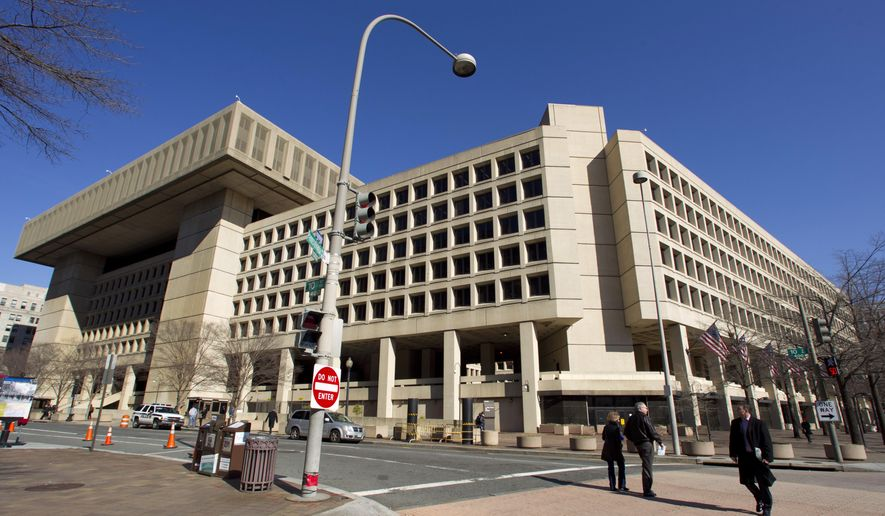 FILE - In this Feb. 3, 2012 file photo, the Federal Bureau of Investigation (FBI) headquarters in Washington. The government is scrapping a decade-long plan to shutter the FBI's deteriorating downtown Washington headquarters and look for a new building in Maryland or Virginia. (AP Photo/Manuel Balce Ceneta, File)