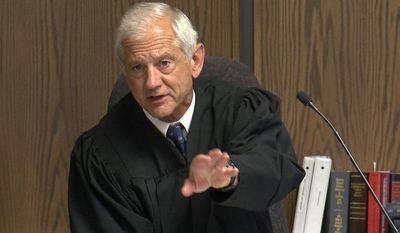 District Court Judge Larry Schwartz makes comments while presiding over the trail of former El Paso County Sheriff Terry Maketa in Colorado Springs, Colo., Monday, July 10, 2017. Jurors began deliberating Monday. The former lawman is accused of trying to undermine the credibility of three deputies and threatening to terminate a $5.3 million contract with the jail's health provider if it did not fire an employee who refused to support then-Undersheriff Paula Presley's candidacy to succeed him. (Adam Knapik/KOAA-TV via AP, Pool)