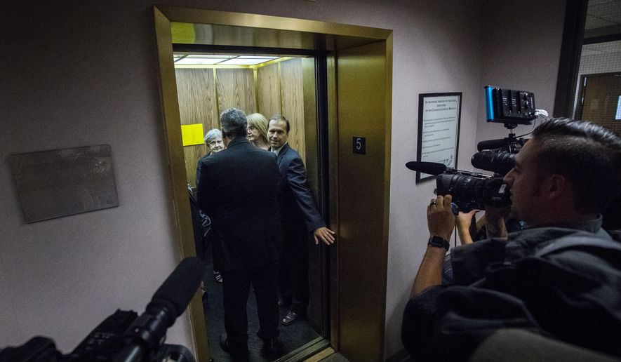 Former El Paso County Sheriff Terry Maketa leaves the courtroom with his defense team Tuesday, July 11, 2017, in Colorado Springs, Colo. A judge declared a partial mistrial Tuesday after Maketa accused of official misconduct was acquitted of three of seven counts. (Christian Murdock/The Gazette via AP)