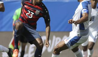 FILE - In this July 8, 2017, file photo, United States' Kellyn Acosta (23) controls the ball as Panama's Gabriel Gomez (6) challenges him during a CONCACAF Gold Cup soccer match, in Nashville, Tenn. Acosta is young, talented and playing his way into a bigger role with the United States men's national soccer team, which is preparing to meet Martinique in its second CONCACAF Gold Cup match. (AP Photo/Mark Humphrey, File)