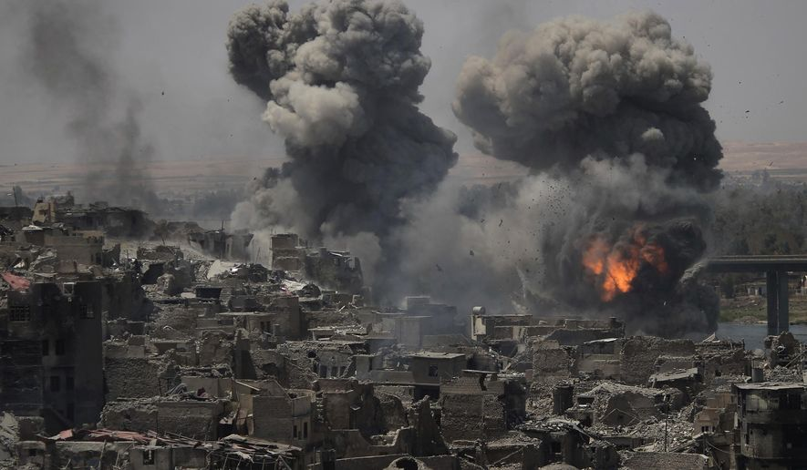 """Airstrikes target Islamic State positions on the edge of the Old City a day after Iraq's prime minister declared """"total victory"""" in Mosul, Iraq, Tuesday, July 11, 2017. (AP Photo/Felipe Dana)"""