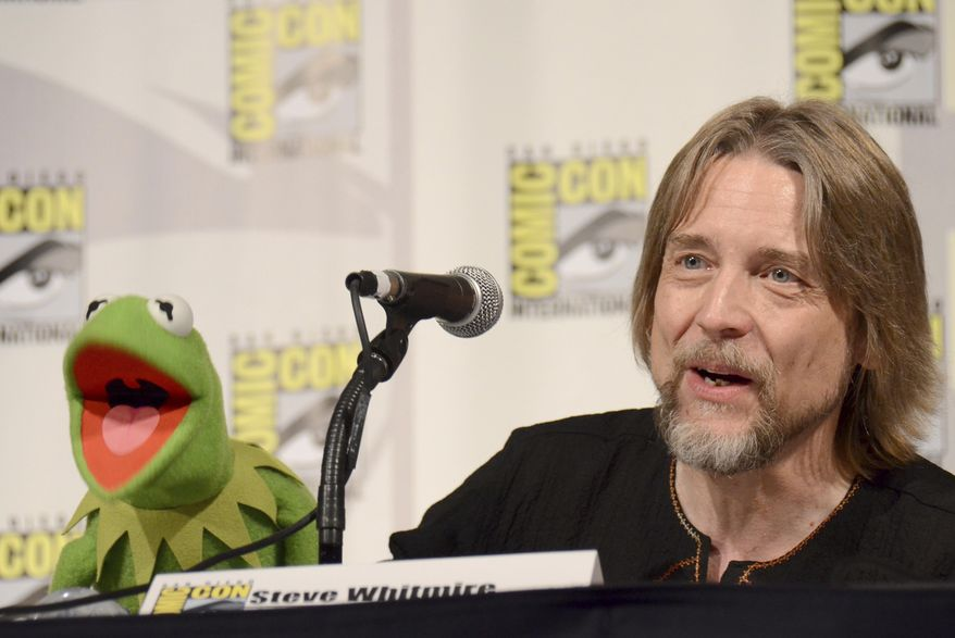 "FILE - In this July 11, 2015, file photo, Kermit the Frog, left, and puppeteer Steve Whitmire attend ""The Muppets"" panel on day 3 of Comic-Con International in San Diego. ABC News and The Hollywood Reporter reported July 10, 2017, that Whitmire is no longer performing the character. (Photo by Tonya Wise/Invision/AP, File)"