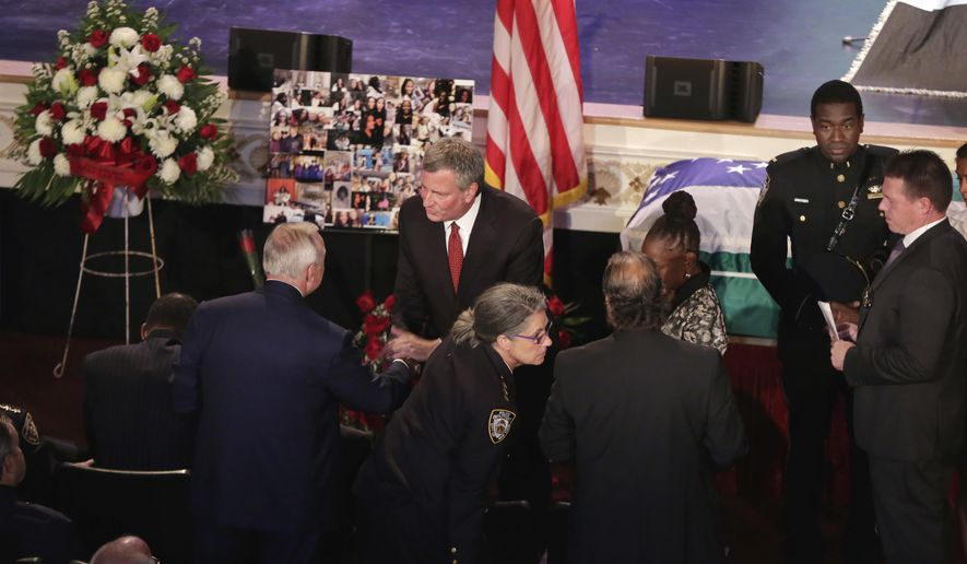 New York City Mayor Bill deBlasio, standing center, greets former New York City Police Commissioner William Bratton as he arrives for the funeral for New York City Police Officer Miosotis Familia, at the World Changers Church, in the Bronx borough of New York, Tuesday, July 11, 2017. The slain officer was writing in her memo book last Wednesday when a man walked up to the police vehicle where she was sitting and fired. (AP Photo/Richard Drew, Pool)
