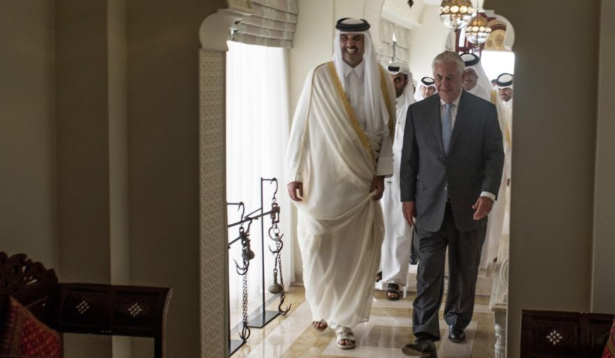 The Emir of Qatar, Sheikh Tamim Bin Hamad Al Thani, left, welcomes U.S. Secretary of State Rex Tillerson to Sea Palace, his official residence, in Doha, Qatar, Tuesday, July 11, 2017.  Tillerson arrived in Qatar as he tries to mediate a dispute between the energy-rich country and its Gulf neighbors. The visit is Tillerson's second stop on a shuttle-diplomacy tour that is also expected to take him to Saudi Arabia, which shares Qatar's only land border and is the most powerful of the four countries lined up against it.(Alexander W. Riedel/US State Department via AP)