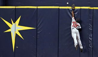 Boston Red Sox center fielder Jackie Bradley Jr. reaches for a home run hit by Tampa Bay Rays' Brad Miller during the eighth inning of a baseball game Sunday, July 9, 2017, in St. Petersburg, Fla. (AP Photo/Mike Carlson)