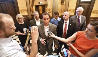 """Michigan Speaker of the House, Tom Leonard, R-Lansing, speaks briefly with members of the media after a meeting with Gov. Snyder in the Capitol on Tuesday, July 11, 2017. Leonard told the writers that he had no news to share with them regarding the """"Good Jobs"""" bill package. (Dale G Young/The Detroit News via AP)"""