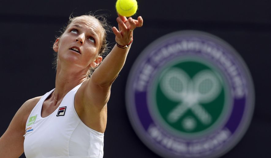 FILE - In this Tuesday, July 4, 2017 file photo Czech Republic's Karolina Pliskova serves to Russia's Evgeniya Rodina during their Women's Singles Match on day two at the Wimbledon Tennis Championships in London. (AP Photo/Kirsty Wigglesworth, File)