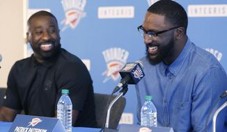 Oklahoma City Thunder guard Raymond Felton, left, and forward Patrick Patterson, right, laugh at a question during a news conference to introduce the players in Oklahoma City, Tuesday, July 11, 2017. Felton and Patterson have each played in the NBA long enough to appreciate the importance of playing for a team with legitimate title aspirations. (AP Photo/Sue Ogrocki)