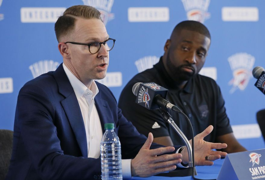 Sam Presti, left, Oklahoma City general manager, answers a question as newly signed guard Raymond Felton, right, looks on, at a news conference in Oklahoma City, Tuesday, July 11, 2017. Oklahoma City is attempting to regain its status as a championship title contender after making a first-round playoff exit in its first season without Kevin Durant, who left for Golden State and helped the Warriors win their second title in three years. (AP Photo/Sue Ogrocki)