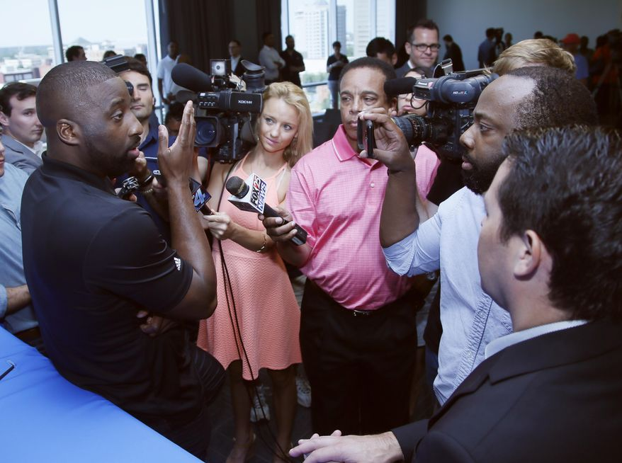 Newly signed Oklahoma City Thunder guard Raymond Felton, left, answers question following a news conference in Oklahoma City, Tuesday, July 11, 2017. Oklahoma City is attempting to regain its status as a championship title contender after making a first-round playoff exit in its first season without Kevin Durant, who left for Golden State and helped the Warriors win their second title in three years. (AP Photo/Sue Ogrocki)