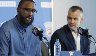 Patrick Patterson, left, newly signed Oklahoma City Thunder forward, answers a question as Billy Donovan, right, head coach, looks on at a news conference in Oklahoma City, Tuesday, July 11, 2017. Patterson said the ability to play for a potential winner helped drive his decision to sign with Oklahoma City. His familiarity with Donovan also helped. (AP Photo/Sue Ogrocki)