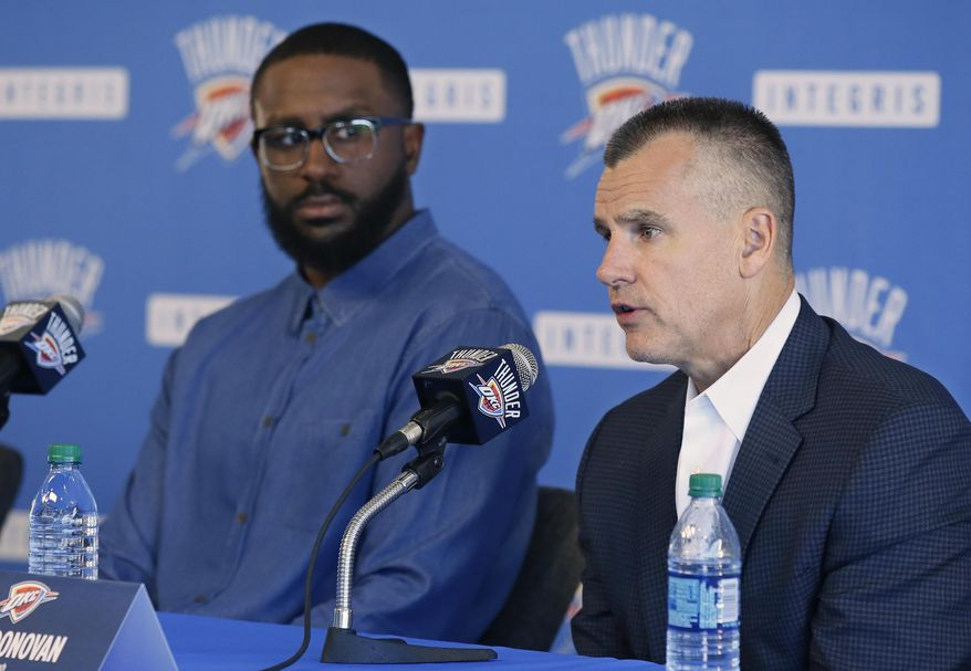 Patrick Patterson, left, newly signed Oklahoma City Thunder forward, looks on as Billy Donovan, right, head coach, answers a question at a news conference in Oklahoma City, Tuesday, July 11, 2017. Oklahoma City is attempting to regain its status as a championship title contender after making a first-round playoff exit in its first season without Kevin Durant, who left for Golden State and helped the Warriors win their second title in three years. (AP Photo/Sue Ogrocki)