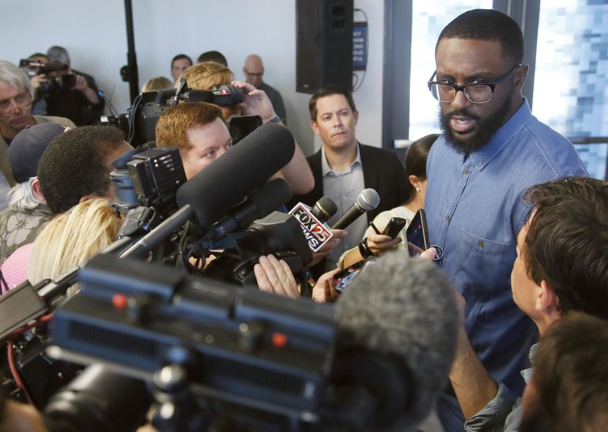Newly signed Oklahoma City Thunder forward Patrick Patterson, right, answers a question following a news conference in Oklahoma City, Tuesday, July 11, 2017. Oklahoma City is attempting to regain its status as a championship title contender after making a first-round playoff exit in its first season without Kevin Durant, who left for Golden State and helped the Warriors win their second title in three years. (AP Photo/Sue Ogrocki)