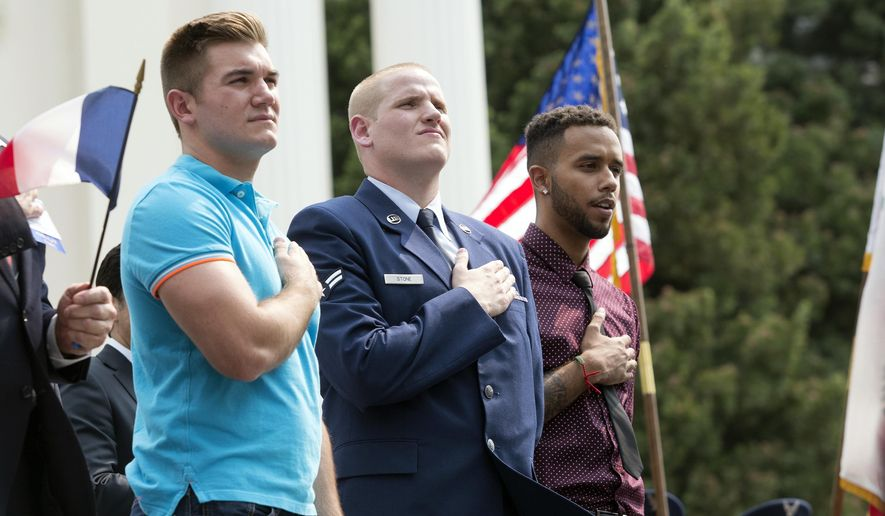 "In this Sept. 11, 2015, file photo, Oregon National Guardsman Alek Skarlatos, left, U.S. Airman Spencer Stone, center, and Anthony Sadler attend a parade held to honor the three Americans who stopped a gunman on a Paris-bound passenger train, in Sacramento, Calif. The three Sacramento-area men who thwarted a terror attack on a French train in 2015 will play themselves in a Clint Eastwood-directed film about their heroic feat. Sadler, Skarlatos, and Stone will star in ""15:17 to Paris,"" which began production this week. (AP Photo/Carl Costas, File)"