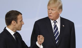 In this July 7, 2017, file photo, France's President Emmanuel Macron talks with U.S. President Donald Trump after the family photo on the first day of the G-20 summit in Hamburg, Germany. (AP Photo/Michael Sohn, File)