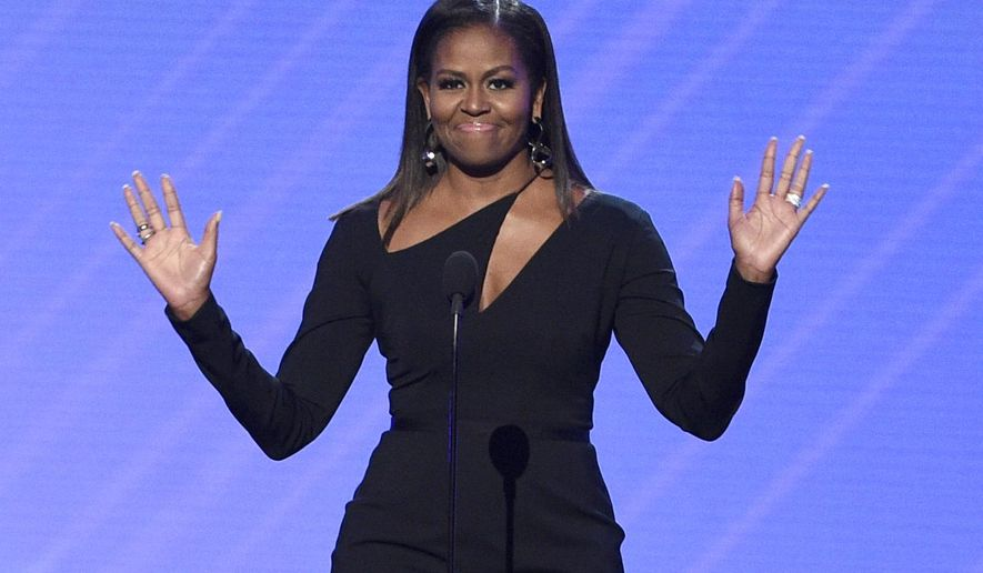 Former first lady Michelle Obama presents the Arthur Ashe Courage Award at the ESPYS at the Microsoft Theater on Wednesday, July 12, 2017, in Los Angeles. (Photo by Chris Pizzello/Invision/AP)