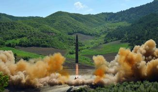 The July 4 launch of a Hwasong-14 intercontinental ballistic missile from North Korea showed that a rogue dictator stands on the verge of possessing nuclear missiles that threaten U.S. shores. (Associated Press/File)