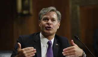 """""""If I am given the honor of leading this agency, I will never allow the FBI's work to be driven by anything other than the facts, the law and the impartial pursuit of justice. Period. Full stop,"""" Christopher Wray told the Senate Judiciary Committee during his confirmation hearing. (Associated Press) ** FILE **"""