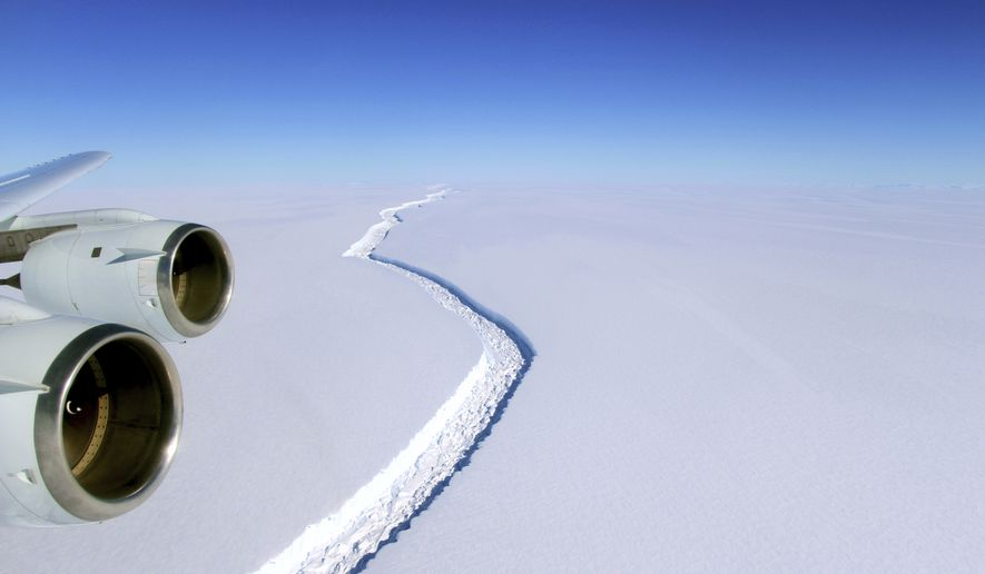 This Nov. 10, 2016 aerial photo released by NASA, shows a rift in the Antarctic Peninsula's Larsen C ice shelf. A vast iceberg with twice the volume of Lake Erie has broken off from a key floating ice shelf in Antarctica, scientists said Wednesday July 12, 2017. The iceberg broke off from the Larsen C ice shelf, scientists at the University of Swansea in Britain said. The iceberg, which is likely to be named A68, is described as weighing 1 trillion tons (1.12 trillion U.S. tons).(John Sonntag/NASA via AP)