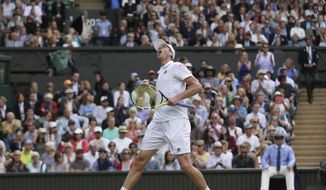 Sam Querrey of the United States celebrates after beating Britain's Andy Murray at the end of their Men's Singles Quarterfinal Match on day nine at the Wimbledon Tennis Championships in London Wednesday, July 12, 2017. (AP Photo/Tim Ireland)