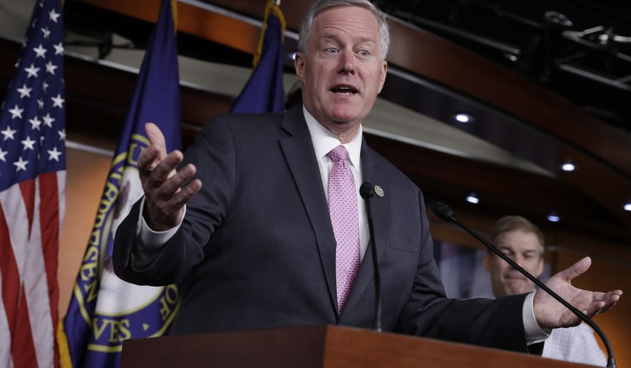 House Freedom Caucus Chairman Rep. Mark Meadows, R-N.C. speaks during a news conference on Capitol Hill in Washington, Wednesday, July 12, 2017, to say that his group wants to delay the traditional August recess until work is accomplished on health care, the debt ceiling and tax reform. (AP Photo/J. Scott Applewhite)