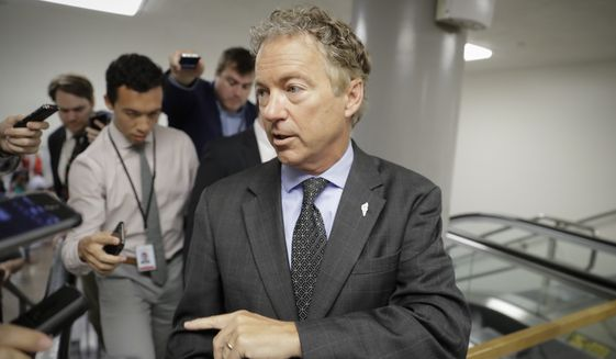 Sen. Rand Paul, R-Ky., a vocal opponent of the Senate Republican healthcare bill, speaks with reporters on his way to a vote on Capitol Hill in Washington, Wednesday, July 12, 2017. (AP Photo/J. Scott Applewhite)