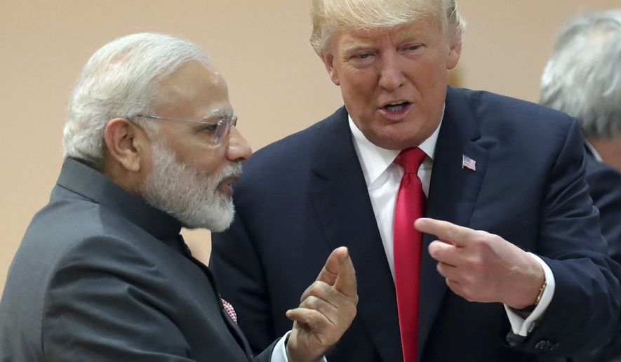 India's Prime Minister Narendra Modi, in conversation with U.S. president Donald Trump during a working session of the G20 summit in Hamburg, Germany, Saturday, July 8, 2017. (Michael Kappeler/Pool Photo via AP)