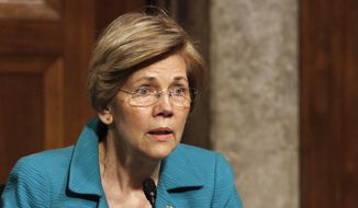 Senate Armed Services Committee member Sen. Elizabeth Warren, D-Mass. questions Navy Secretary nominee Richard Spencer on Capitol Hill in Washington, Tuesday, July 11, 2017, during Spencer's confirmation hearing before the committee. (AP Photo/Jacquelyn Martin)