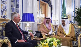 U.S. Secretary of State Rex Tillerson, left, meets with Saudi King Salman, right, in Jiddah, Saudi Arabia, Wednesday, July 12, 2017. Tillerson has held talks with the king of Saudi Arabia and other officials from the countries lined up against Qatar, but there has been no sign of a breakthrough so far in an increasingly entrenched dispute that has divided some of America's most important Mideast allies. (U.S. State Department, via AP)