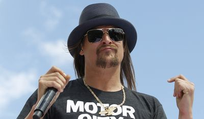 In this Feb. 22, 2015, file photo, Kid Rock performs before the Daytona 500 NASCAR Sprint Cup series auto race at Daytona International Speedway in Daytona Beach, Fla. (AP Photo/Terry Renna, File)