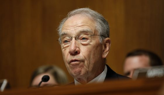 Senate Judiciary Committee Chairman Sen. Chuck Grassley, R-Iowa listens  on Capitol Hill in Washington, Wednesday, July 12, 2017, during the committee's confirmation hearing for FBI Director nominee Christopher Wray. (AP Photo/Pablo Martinez Monsivais)