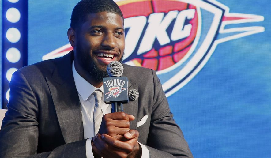 Oklahoma City Thunder forward Paul George speaks to at a rally to introduce him to fans in Oklahoma City, Wednesday, July 12, 2017. (AP Photo/Sue Ogrocki)