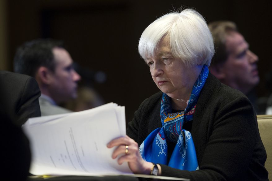 In this Thursday, March 23, 2017, file photo, Federal Reserve Chair Janet Yellen looks at documents while waiting to speak at the Federal Reserve System Community Development Research Conference in Washington. Beginning Wednesday, July 12, 2017, Yellen speaks to Congress about monetary policy and the state of the economy. (AP Photo/Cliff Owen, File)
