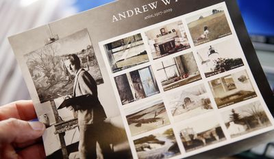 A man picks up a flyer promoting Andrew Wyeth Forever stamps after a First-Day-of-Issue dedication ceremony at the Brandywine River Museum of Art, Wednesday, July 12, 2017, in Chadds Ford, Pa. The panel of 12 Forever stamps feature details from different iconic Andrew Wyeth paintings. (AP Photo/Matt Slocum)
