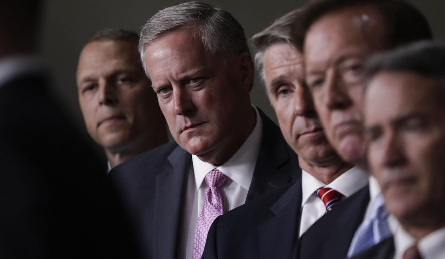 House Freedom Caucus Chairman Rep. Mark Meadows, R-N.C., second from left, and others, participates in a news conference on Capitol Hill in Washington, Wednesday, July 12, 2017, to say that his group wants to delay the traditional August recess until work is accomplished on health care, the debt ceiling and tax reform. (AP Photo/J. Scott Applewhite)