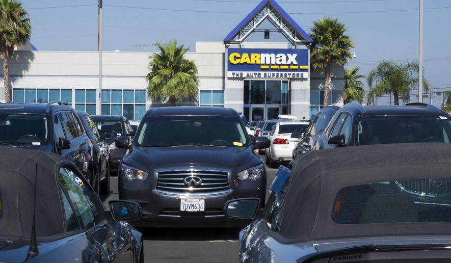 "This June 28, 2017, photo provided by Edmunds shows the lot of a CarMax used-car ""superstore,"" in Inglewood, Calif. Unlike most dealerships, CarMax has a no-haggle pricing policy. (Scott Jacobs/Edmunds.com via AP)"