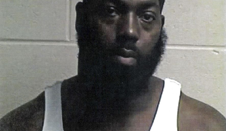 "This undated photo provided by the Sharonville Police Department in Sharonville, Ohio, shows Buffalo Bills defensive tackle Adolphus Washington, a Cincinnati native and former Ohio State football standout who was arrested Sunday, July 9, 2017, and is accused of improperly carrying a concealed weapon. A police report says officers were breaking up a crowd Sunday, July 9, 2017, at a water park in Sharonville, Ohio, when Washington ""reached for and displayed a gun while sitting inside his vehicle, just feet away from officers."" (Sharonville Police Department via AP)"