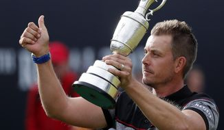 FILE - This is a Sunday, July 17, 2016  file photo of Henrik Stenson of Sweden holds up the trophy tom the crowd after winning the British Open Golf Championships at the Royal Troon Golf Club in Troon, Scotland.  Swedish golfer  Henrik Stenson golfer is playing the Scottish Open beginning Thursday July 13, 2017 at Dundonald Links, which is a 6-mile (10-kilometer) drive up the west coast from Royal Troon, where he won the British Open last year for his first major title. (AP Photo/Ben Curtis/File)