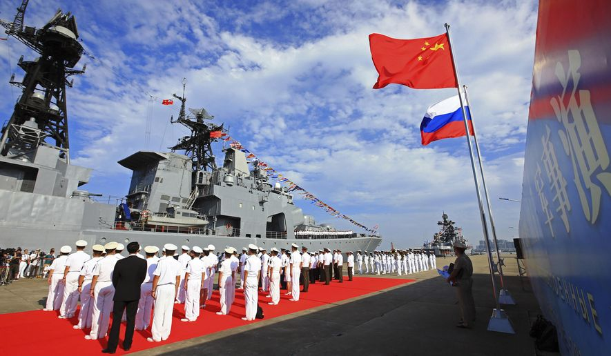 FILE - In this Sept. 12, 2016, photo released by China's Xinhua News Agency, officers and sailors of China's People's Liberation Army (PLA) Navy hold a welcome ceremony as a Russian naval ship arrives in port in Zhanjiang in southern China's Guangdong Province. China says its latest-generation warships have conducted live-firing drills in the Mediterranean Sea Monday, July 10, 2017, while en route to joint exercises with the Russian navy. (Zha Chunming/Xinhua via AP, File)
