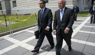David Wildstein, left, walks with his attorney Alan Zegas from a federal court in Newark, N.J., Wednesday, July 12, 2017, after he was sentenced. Wildstein, a former ally to New Jersey Gov. Chris Christie who was the mastermind of the 2013 George Washington Bridge lane-closing scheme, will avoid prison after pleading guilty and giving testimony that helped convict two former aides to him. Federal Judge Susan Wigenton sentenced him to three years' probation, along with 500 hours of community service and a ban on working in government.  (AP Photo/Craig Ruttle)