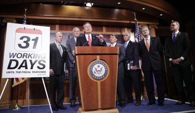 Sen. Steve Daines, R-Mont., center, speaks during a news conference on Capitol Hill in Washington, Tuesday, July 11, 2017, to announce proposing canceling their August recess. From left are, Sen. Dan Sullivan, R-Alaska, Sen. Luther Strange, R-Ala., Daines, Sen. Mike Rounds, R-S.D., Sen. Tom Tillis, R-N.C., Sen. John Kennedy, R-La., and Sen. David Perdue, R-Ga. (AP Photo/Pablo Martinez Monsivais)
