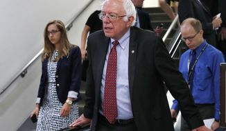 Sen. Bernie Sanders, I-Vt., rides an escalator on Capitol Hill in Washington, Tuesday, July 11, 2017. (AP Photo/Jacquelyn Martin)
