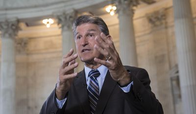 Sen. Joe Manchin, D-W. Va. responds to questions during a TV news interview on Capitol Hill in Washington, Tuesday, July 11, 2017. Manchin pleaded his case for bipartisanship in fixing health care and spending. (AP Photo/J. Scott Applewhite) ** FILE **
