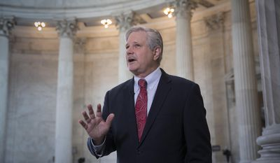 Sen. John Hoeven, R-N.D. responds to questions during a TV news interview on Capitol Hill in Washington, Tuesday, July 11, 2017. Hoeven has indicated that he does not support the GOP health care bill as it is currently written. (AP Photo/J. Scott Applewhite)
