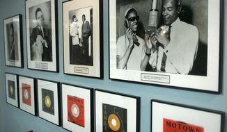 ADVANCE FOR USE SUNDAY, JULY 16, 2017 AND THEREAFTER-FILE - This Jan. 20, 2006 file photo shows 45's and photographs, including Marvin Gaye and Stevie Wonder in a photograph at right, displayed at the Motown Museum gallery in Detroit. The violence in July 1967 was a wake-up call for many at the label that churned out hits by the Vandellas, as well as Smokey Robinson and the Miracles, the Supremes, Stevie Wonder, Marvin Gaye, Temptations, Four Tops and others. (AP Photo/Paul Sancya)