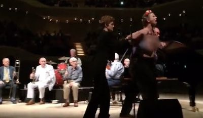 Topless demonstrators with the women's rights group FEMEN stormed the stage at Woody Allen's jazz concert in Germany to protest allegations of sexual abuse against the famed film director. (The Daily Mail)