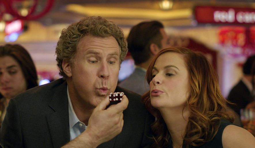 "This image released by Warner Bros Pictures shows Will Ferrell, left, and Amy Poehler in a scene from, ""The House."" The film opened with just $8.7 million, the latest in an increasingly long line of comedy flops at the box office. (Warner Bros. Entertainment via AP)"