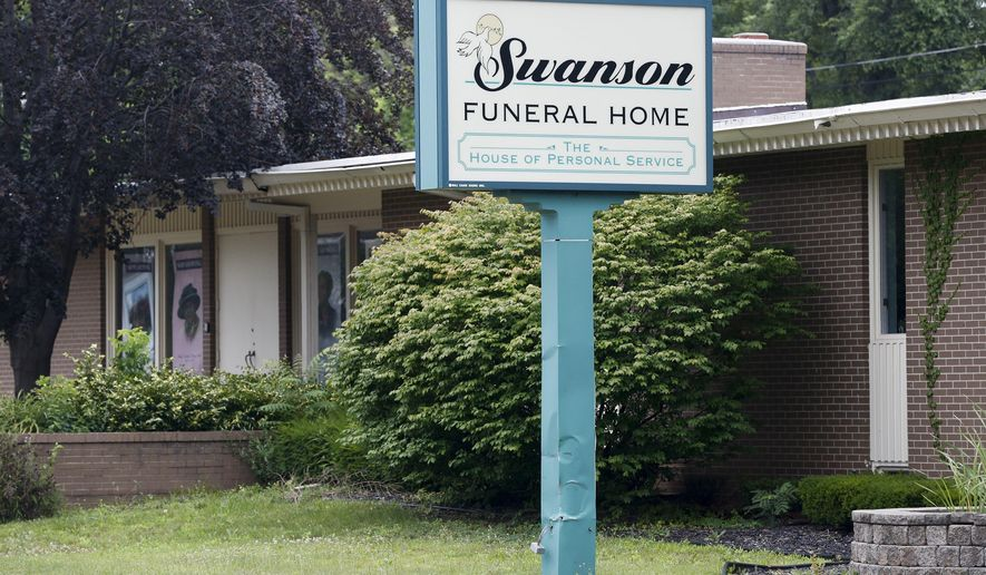 A light rain falls on Swanson Funeral Home on Wednesday, July 12, 2017, on Martin Luther King Avenue in Flint, Mich. The state has shut down the funeral home, saying maggots were in a garage where unrefrigerated bodies were being stored. (Terray Sylvester/The Flint Journal-MLive.com via AP)